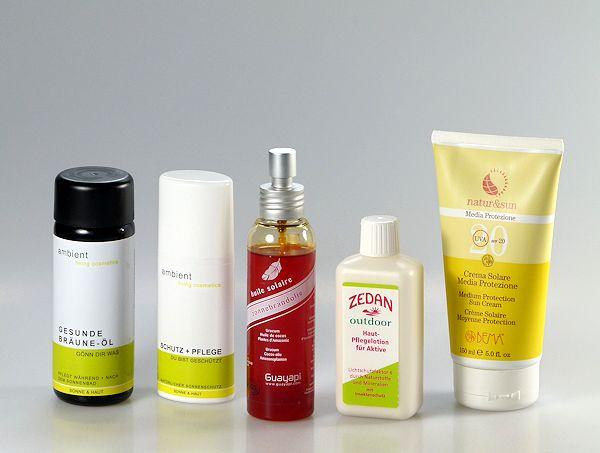 Vier Naturkosmetik Sonnenschutz-Produkte